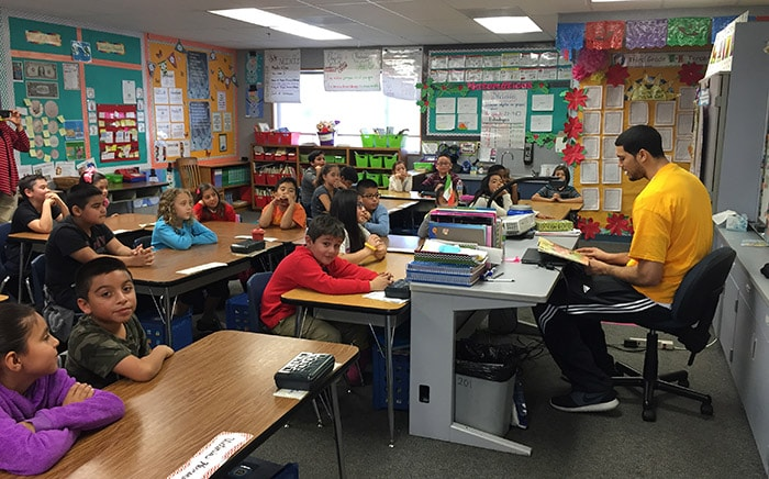 Eloy Vargas reads to students at Ramona Elementary