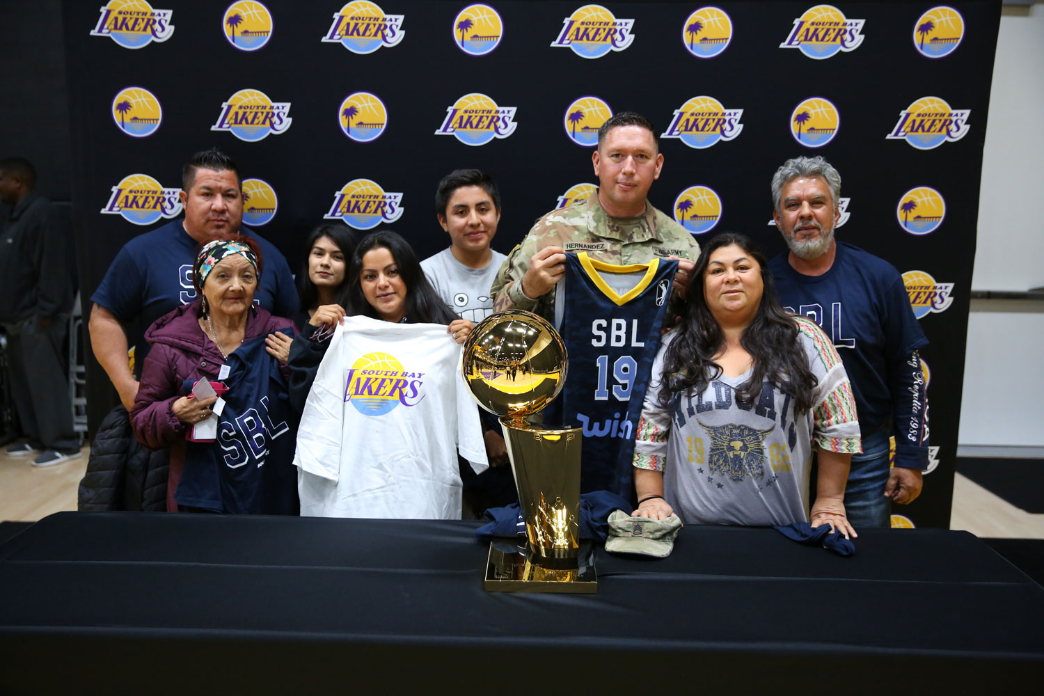 Trophy photo at South Bay Lakers Military Appreciation Night