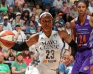 Maya Moore #23 of the Minnesota Lynx handles the ball against the Phoenix Mercury