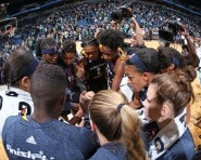 The Indiana Fever celebrate a Game 1 win in the WNBA Finals.