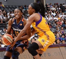 LOS ANGELES, CA - JUNE 26:  Chiney Ogwumike #13 of the Connecticut Sun drives to the basket against Nneka Ogwumike #30 of the Los Angeles Sparks on June 26, 2016 at STAPLES Center in Los Angeles, California.  NOTE TO USER: User expressly acknowledges and agrees that, by downloading and or using this photograph, User is consenting to the terms and conditions of the Getty Images License Agreement. Mandatory Copyright Notice: Copyright 2016 NBAE  (Photo by Aaron Poole/NBAE via Getty Images)