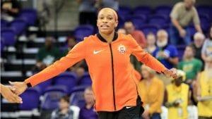 Jasmine Thomas high fives teammate