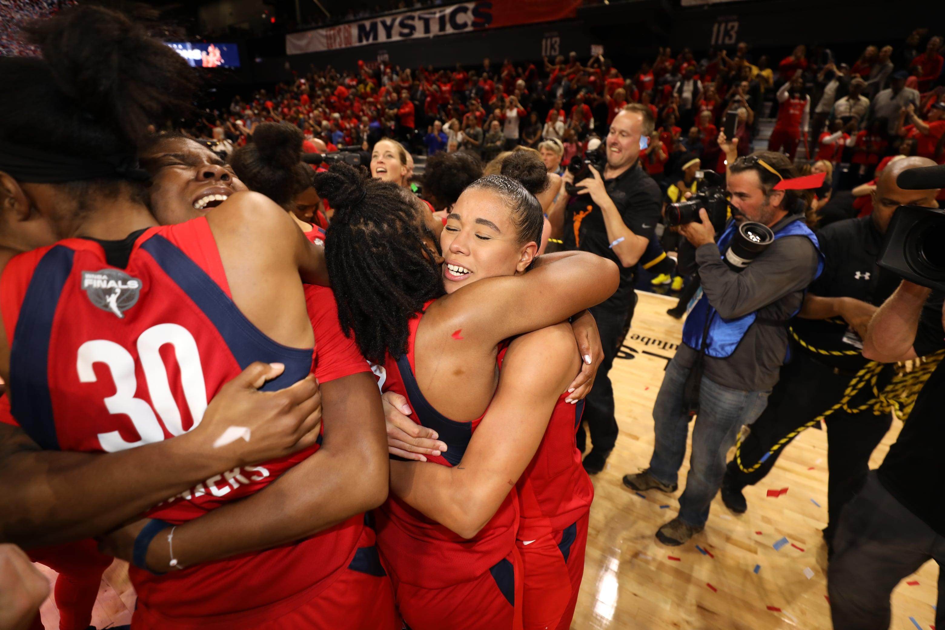 Natasha Cloud and Ariel Atkins hug after winning their first WNBA Championship.