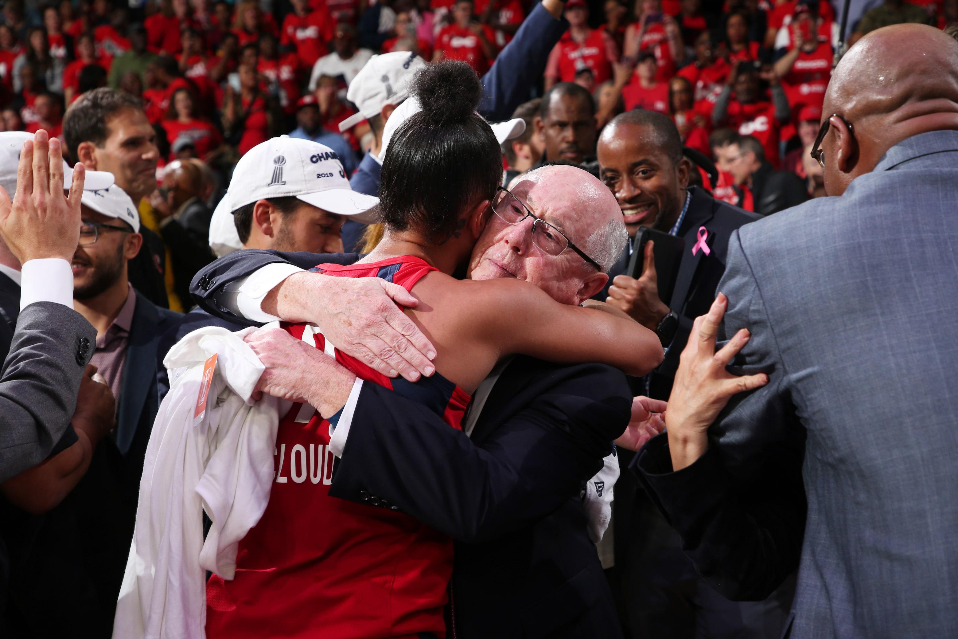 Natasha Cloud embraces head coach Mike Thibault after the Mystics' win.