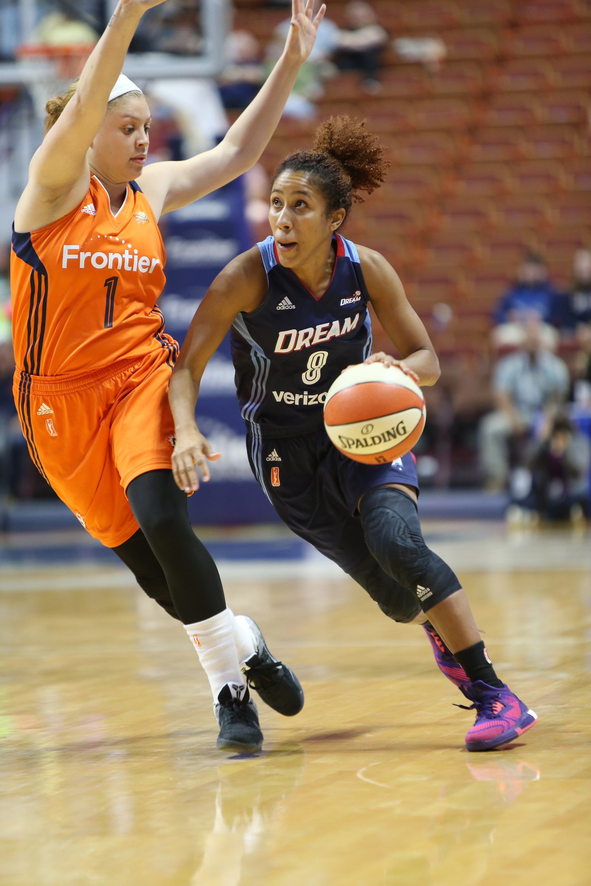 UNCASVILLE, CT - JUNE 3: Carla Cortijo #8 of the Atlanta Dream dribbles the ball against Rachel Banham #1 of the Connecticut Sun on June 3, 2016 at Mohegan Sun Arena in Uncasville, CT. NOTE TO USER: User expressly acknowledges and agrees that, by downloading and or using this Photograph, user is consenting to the terms and conditions of the Getty Images License Agreement. Mandatory Copyright Notice: Copyright 2016 NBAE (Photo by Chris Marion/NBAE via Getty Images)