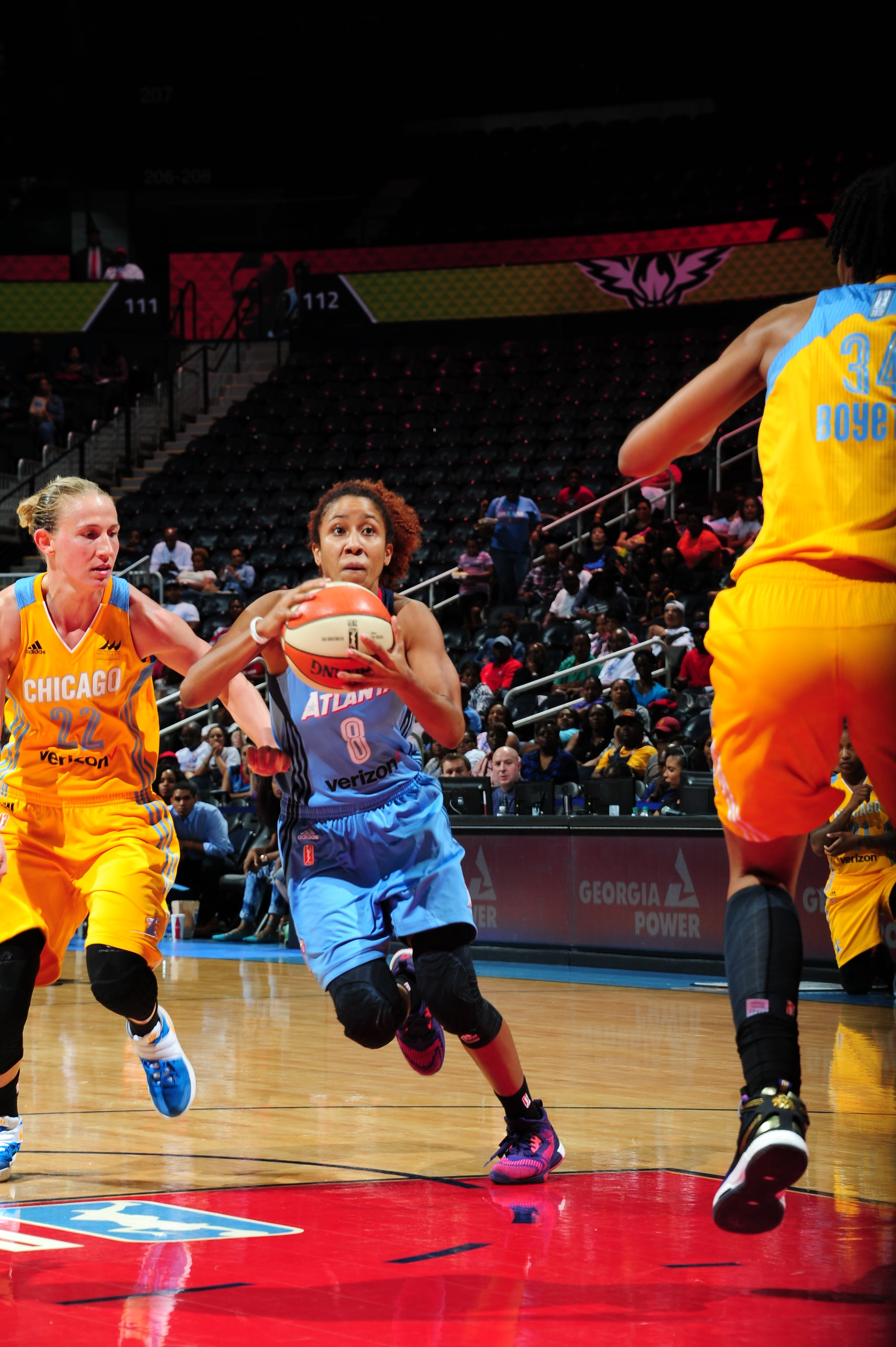 ATLANTA, GA - JUNE 17: Carla Cortijo #8 of the Atlanta Dream drives to the basket against Courtney Vandersloot #22 of the Chicago Sky on June 17, 2016 at Philips Arena in Atlanta, Georgia. NOTE TO USER: User expressly acknowledges and agrees that, by downloading and/or using this Photograph, user is consenting to the terms and conditions of the Getty Images License Agreement. Mandatory Copyright Notice: Copyright 2016 NBAE (Photo by Scott Cunningham/NBAE via Getty Images)