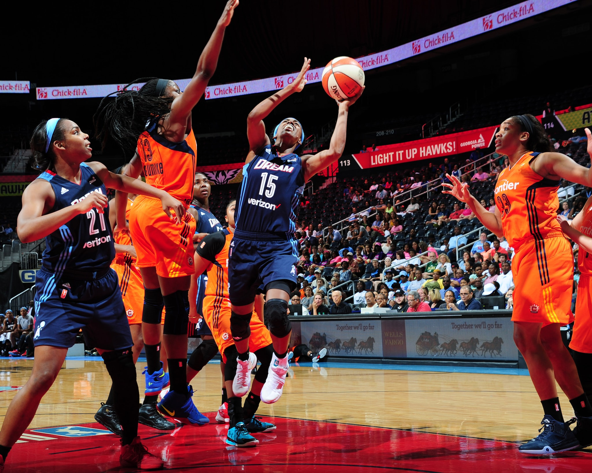 ATLANTA, GA - JUNE 12: Tiffany Hayes #15 of the Atlanta Dream shoots against the Connecticut Sun during the game on June 12, 2016 at Philips Arena in Atlanta, Georgia. NOTE TO USER: User expressly acknowledges and agrees that, by downloading and or using this Photograph, user is consenting to the terms and conditions of the Getty Images License Agreement. Mandatory Copyright Notice: Copyright 2016 NBAE (Photo by Scott Cunningham/NBAE via Getty Images)