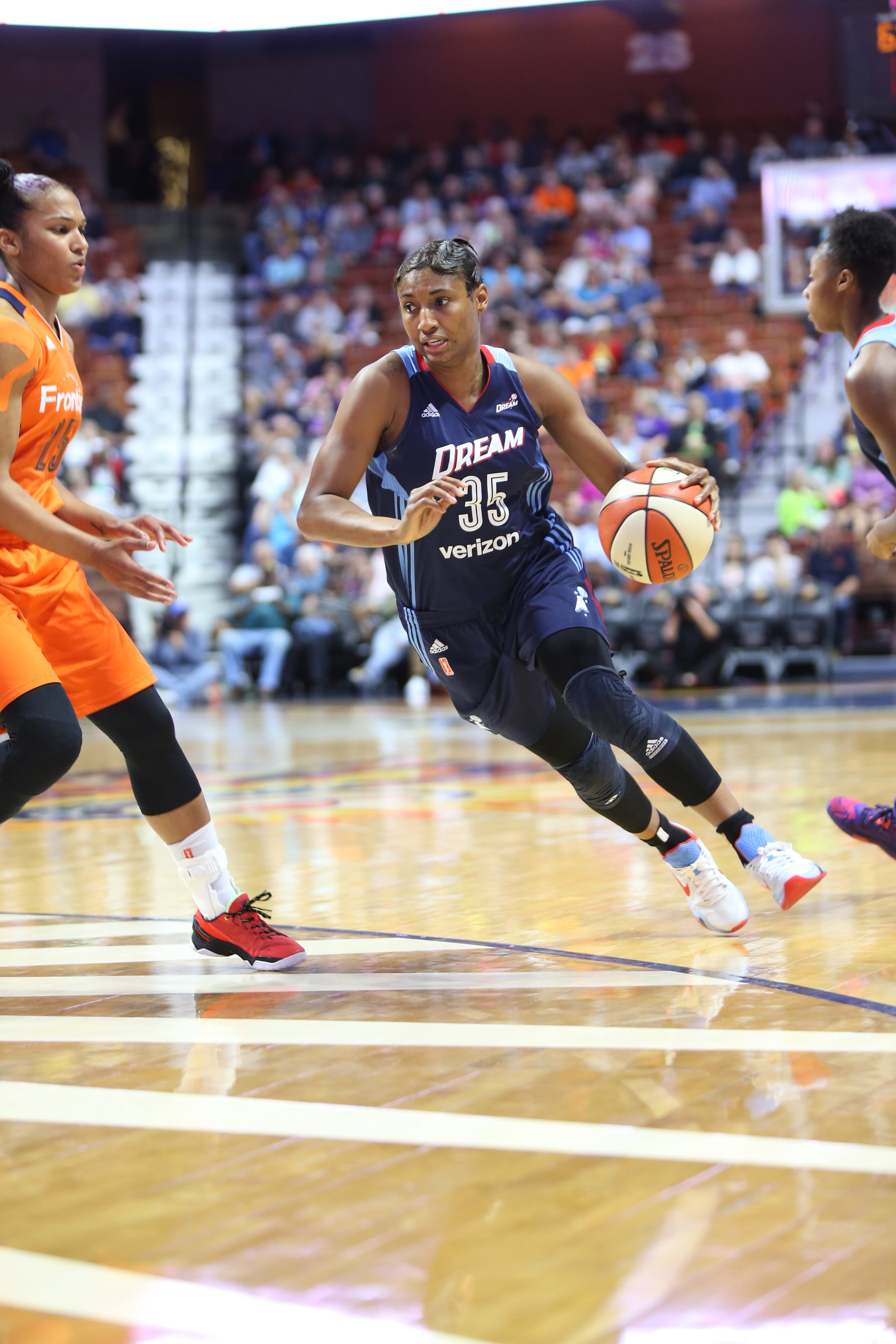 UNCASVILLE, CT - JUNE 3: Angel McCoughtry #35 of the Atlanta Dream handles the ball against the Connecticut Sun on June 3, 2016 at Mohegan Sun Arena in Uncasville, CT. NOTE TO USER: User expressly acknowledges and agrees that, by downloading and or using this Photograph, user is consenting to the terms and conditions of the Getty Images License Agreement. Mandatory Copyright Notice: Copyright 2016 NBAE (Photo by Chris Marion/NBAE via Getty Images)