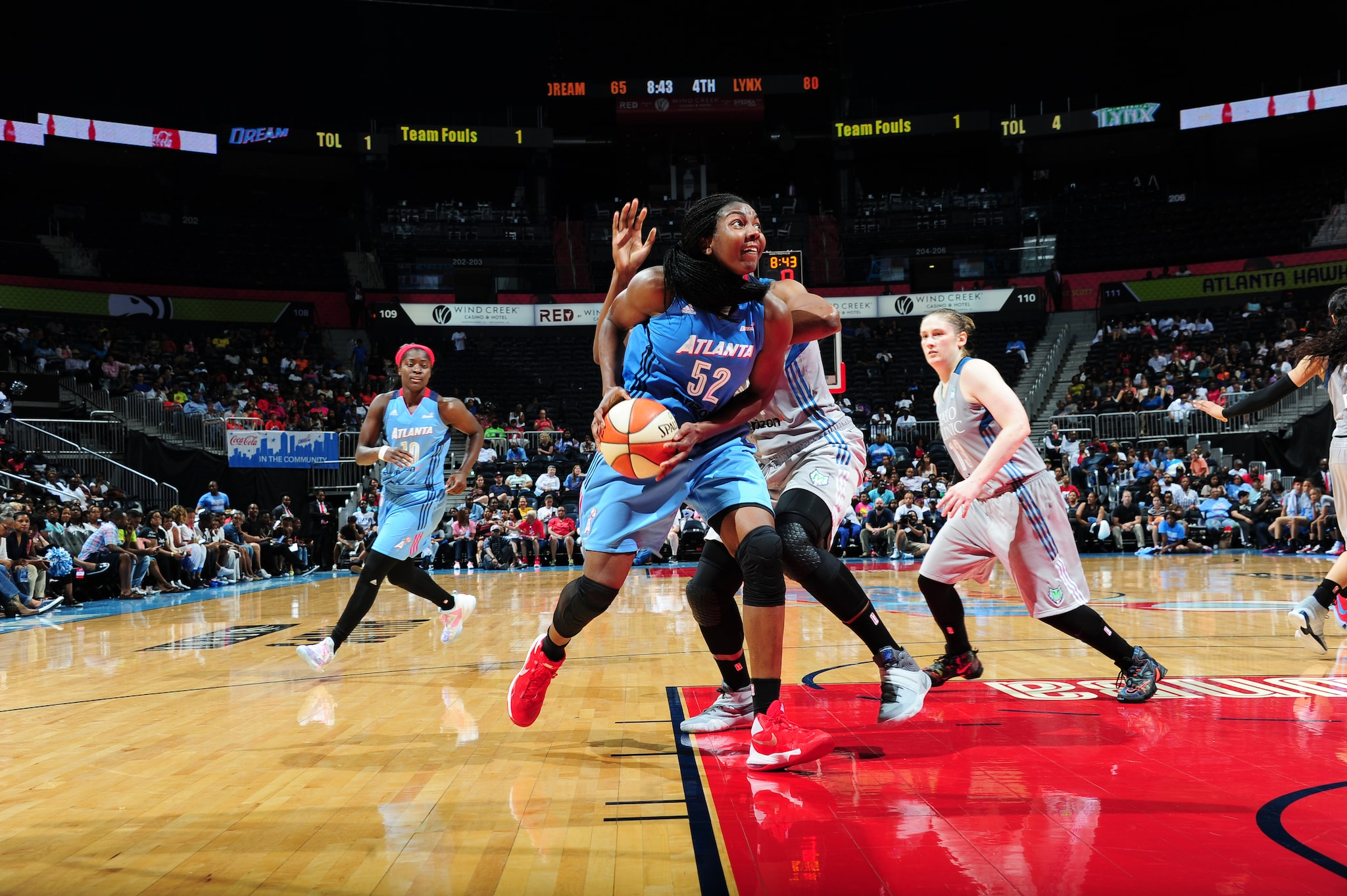 ATLANTA, GA - JUNE 10: Elizabeth Williams #52 of the Atlanta Dream handles the ball against the Minnesota Lynx on June 10, 2016 at Philips Arena in Atlanta, Georgia. NOTE TO USER: User expressly acknowledges and agrees that, by downloading and/or using this Photograph, user is consenting to the terms and conditions of the Getty Images License Agreement. Mandatory Copyright Notice: Copyright 2016 NBAE (Photo by Scott Cunningham/NBAE via Getty Images)