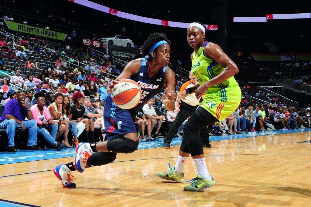 ATLANTA, GA - JULY 8: Tiffany Hayes #15 of the Atlanta Dream drives to the basket during the game against Karima Christmas #13 of the Dallas Wings on July 8, 2016 at Philips Arena in Atlanta, Georgia. NOTE TO USER: User expressly acknowledges and agrees that, by downloading and/or using this Photograph, user is consenting to the terms and conditions of the Getty Images License Agreement. Mandatory Copyright Notice: Copyright 2016 NBAE (Photo by Scott Cunningham/NBAE via Getty Images)