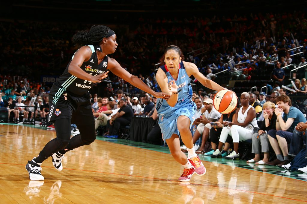 NEW YORK, NY - JULY 13: Meighan Simmons #0 of the Atlanta Dream drives to the basket against Brittany Boyd #15 of the New York Liberty on July 13, 2016 at Madison Square Garden in New York, New York. NOTE TO USER: User expressly acknowledges and agrees that, by downloading and or using this photograph, User is consenting to the terms and conditions of the Getty Images License Agreement. Mandatory Copyright Notice: Copyright 2016 NBAE (Photo by Nathaniel S. Butler/NBAE via Getty Images)