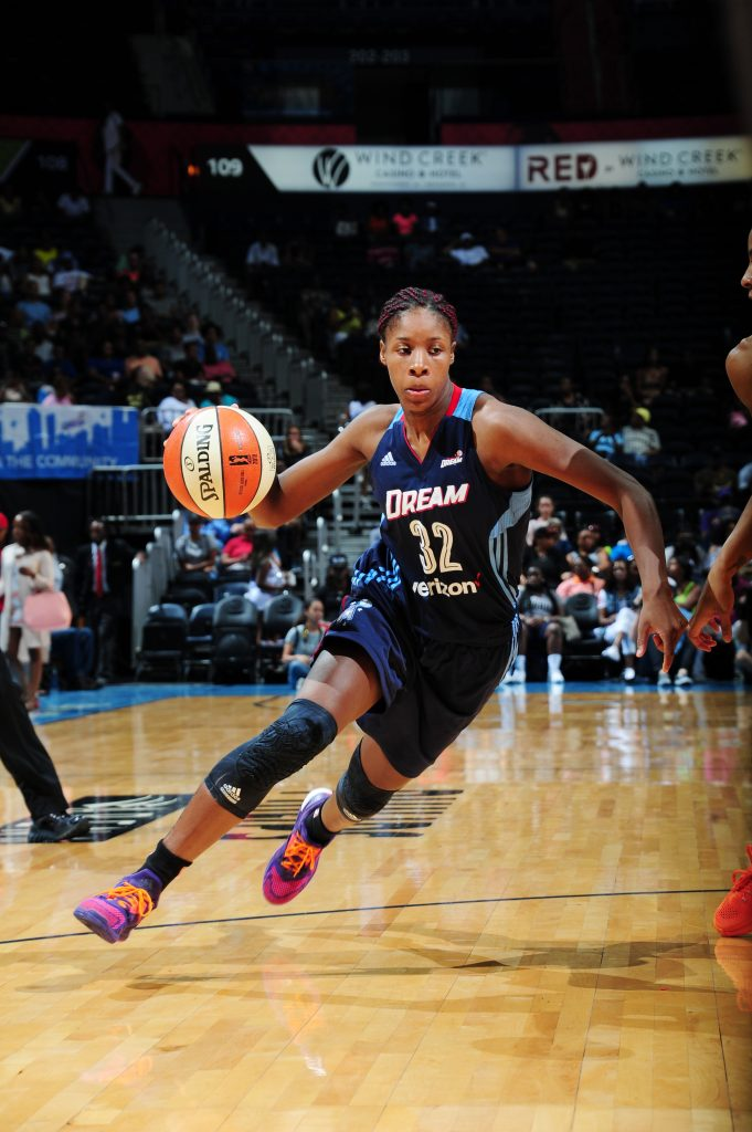 ATLANTA, GA - JULY 17: Bria Holmes #32 of the Atlanta Dream drives to the basket against the Los Angeles Sparks on July 17, 2016 at Philips Arena in Atlanta, Georgia. NOTE TO USER: User expressly acknowledges and agrees that, by downloading and/or using this Photograph, user is consenting to the terms and conditions of the Getty Images License Agreement. Mandatory Copyright Notice: Copyright 2016 NBAE (Photo by Scott Cunningham/NBAE via Getty Images)