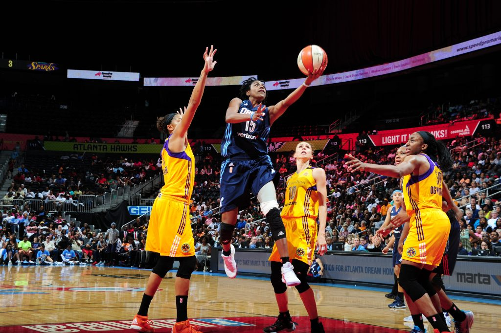 ATLANTA, GA - JULY 17: Tiffany Hayes #15 of the Atlanta Dream shoots a lay up against the Los Angeles Sparks on July 17, 2016 at Philips Arena in Atlanta, Georgia. NOTE TO USER: User expressly acknowledges and agrees that, by downloading and/or using this Photograph, user is consenting to the terms and conditions of the Getty Images License Agreement. Mandatory Copyright Notice: Copyright 2016 NBAE (Photo by Scott Cunningham/NBAE via Getty Images)
