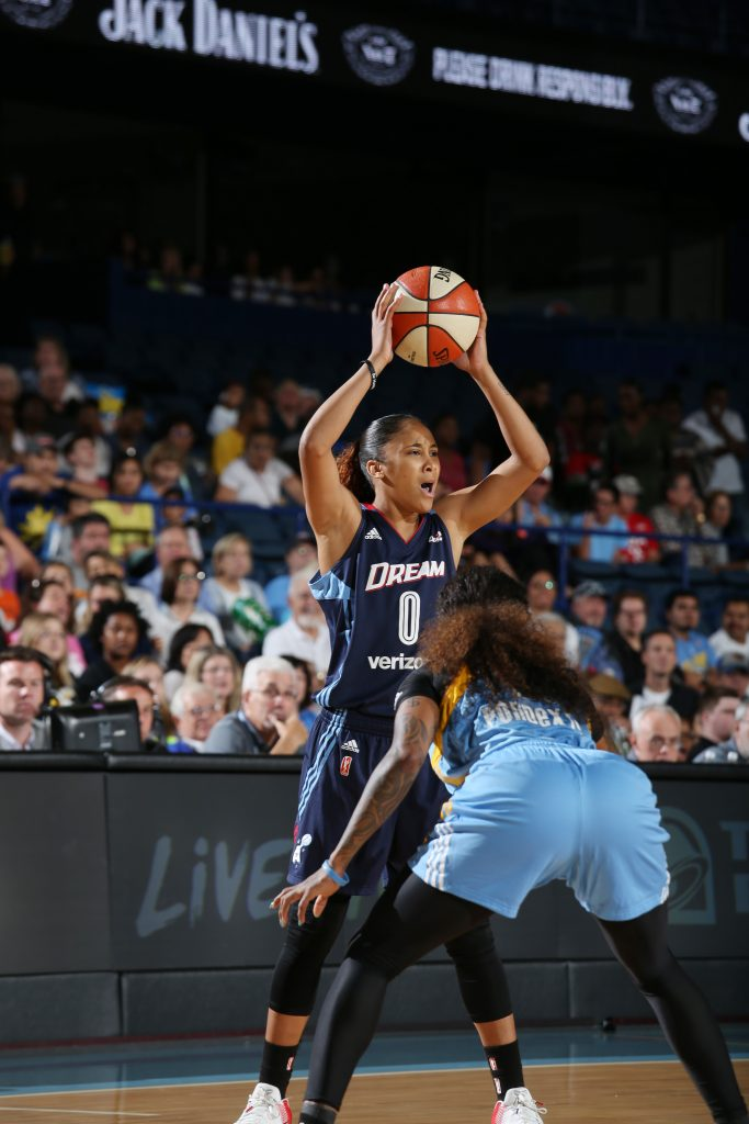 ROSEMONT, IL - SEPTEMBER 25: Meighan Simmons #0 of the Atlanta Dream passes the ball against the Chicago Sky during Round Two of the 2016 WNBA Playoffs on September 25, 2016 at Allstate Arena in Rosemont, IL. NOTE TO USER: User expressly acknowledges and agrees that, by downloading and or using this photograph, User is consenting to the terms and conditions of the Getty Images License Agreement. Mandatory Copyright Notice: Copyright 2016 NBAE (Photo by Gary Dineen/NBAE via Getty Images)