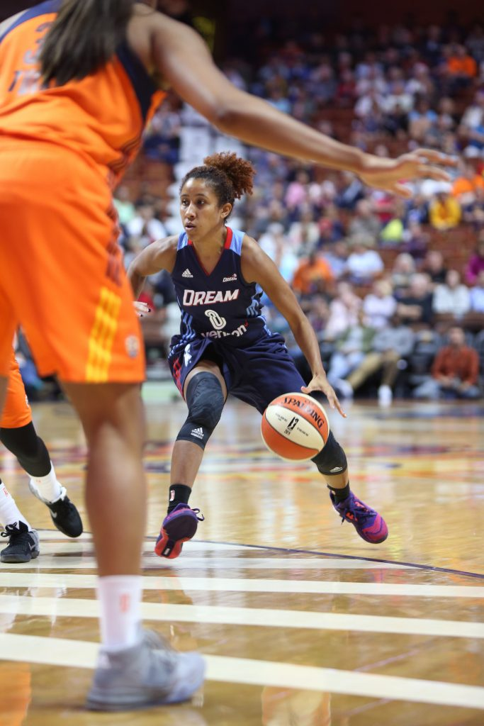 UNCASVILLE, CT - JUNE 3: Carla Cortijo #8 of the Atlanta Dream dribbles the ball against the Connecticut Sun on June 3, 2016 at Mohegan Sun Arena in Uncasville, CT. NOTE TO USER: User expressly acknowledges and agrees that, by downloading and or using this Photograph, user is consenting to the terms and conditions of the Getty Images License Agreement. Mandatory Copyright Notice: Copyright 2016 NBAE (Photo by Chris Marion/NBAE via Getty Images)