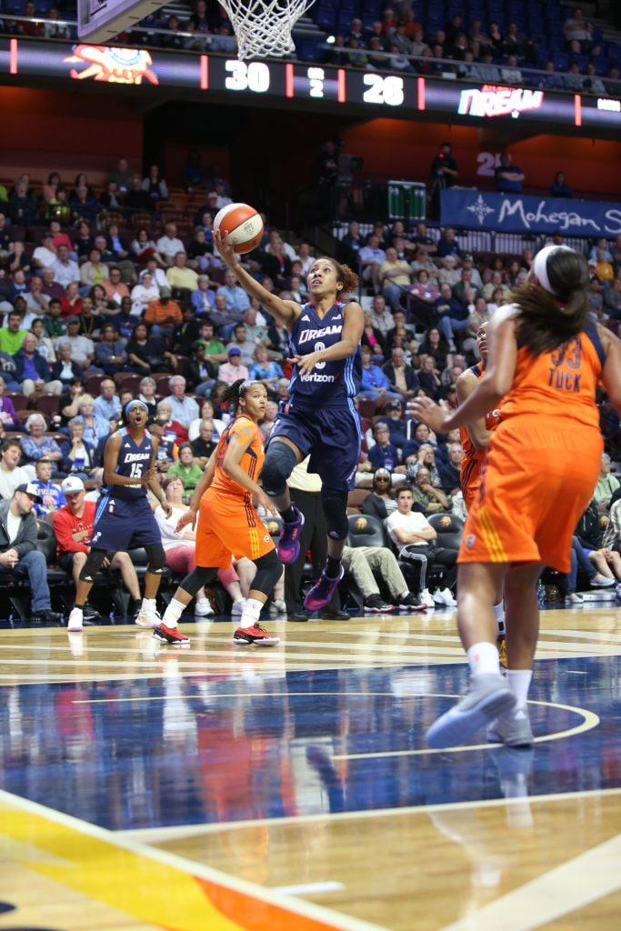 UNCASVILLE, CT - JUNE 3: Carla Cortijo #8 of the Atlanta Dream goes for the layup against the Connecticut Sun on June 3, 2016 at Mohegan Sun Arena in Uncasville, CT. NOTE TO USER: User expressly acknowledges and agrees that, by downloading and or using this Photograph, user is consenting to the terms and conditions of the Getty Images License Agreement. Mandatory Copyright Notice: Copyright 2016 NBAE (Photo by Chris Marion/NBAE via Getty Images)