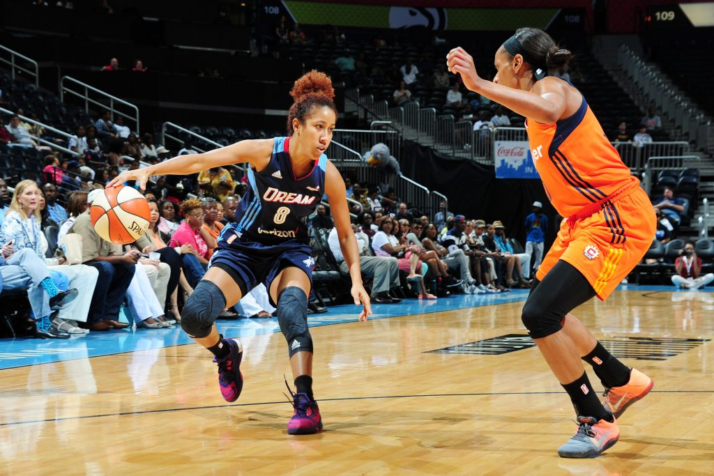 ATLANTA, GA - JUNE 12: Carla Cortijo #8 of the Atlanta Dream defends the ball against the Connecticut Sun during the game on June 12, 2016 at Philips Arena in Atlanta, Georgia. NOTE TO USER: User expressly acknowledges and agrees that, by downloading and or using this Photograph, user is consenting to the terms and conditions of the Getty Images License Agreement. Mandatory Copyright Notice: Copyright 2016 NBAE (Photo by Scott Cunningham/NBAE via Getty Images)