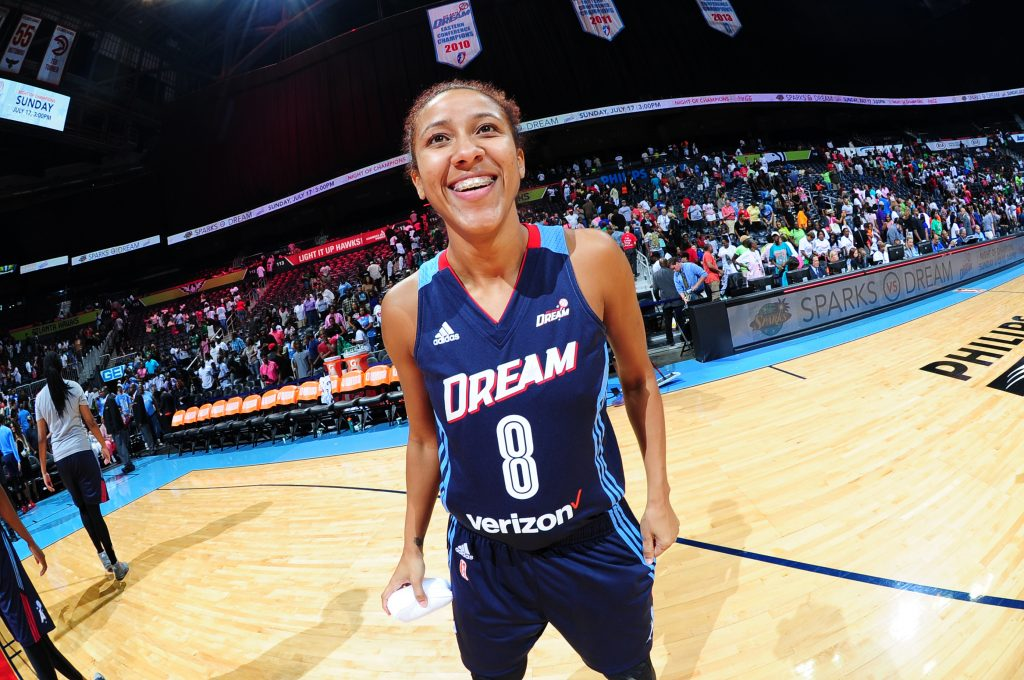 ATLANTA, GA - JULY 8: Carla Cortijo #8 of the Atlanta Dream celebrates a win against the Dallas Wings on July 8, 2016 at Philips Arena in Atlanta, Georgia. NOTE TO USER: User expressly acknowledges and agrees that, by downloading and/or using this Photograph, user is consenting to the terms and conditions of the Getty Images License Agreement. Mandatory Copyright Notice: Copyright 2016 NBAE (Photo by Scott Cunningham/NBAE via Getty Images)