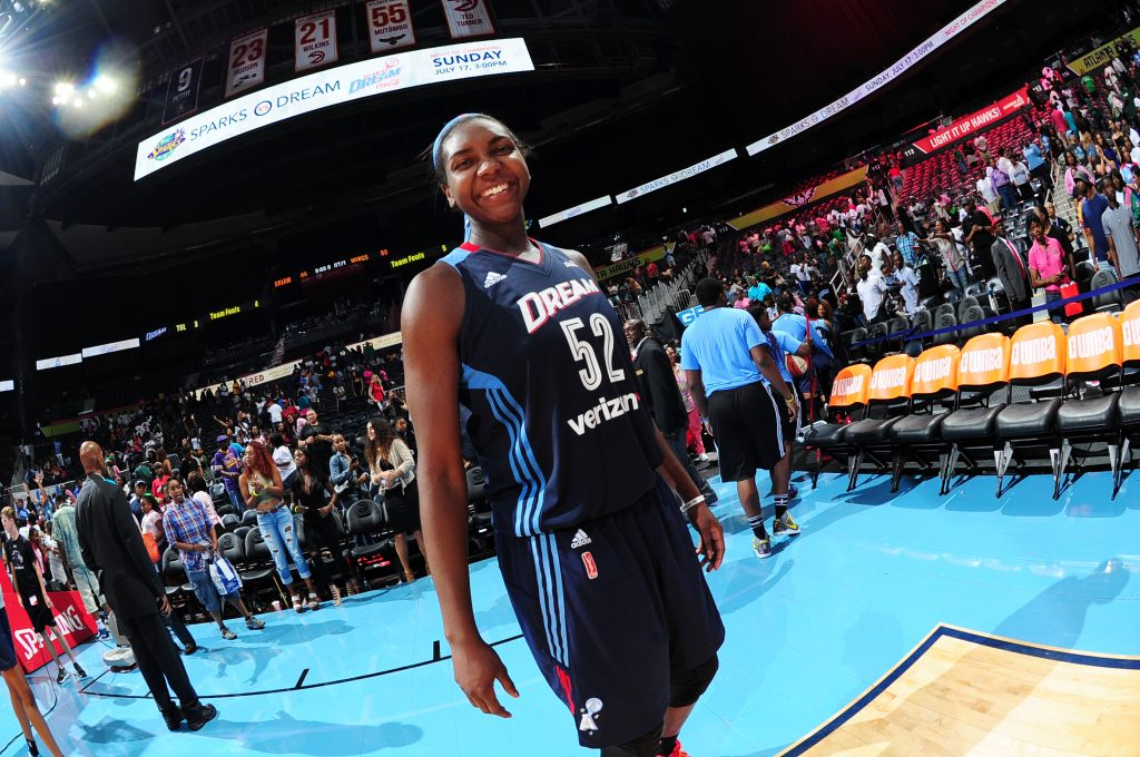 ATLANTA, GA - JULY 8: Elizabeth Williams #52 of the Atlanta Dream celebrates a win against the Dallas Wings on July 8, 2016 at Philips Arena in Atlanta, Georgia. NOTE TO USER: User expressly acknowledges and agrees that, by downloading and/or using this Photograph, user is consenting to the terms and conditions of the Getty Images License Agreement. Mandatory Copyright Notice: Copyright 2016 NBAE (Photo by Scott Cunningham/NBAE via Getty Images)