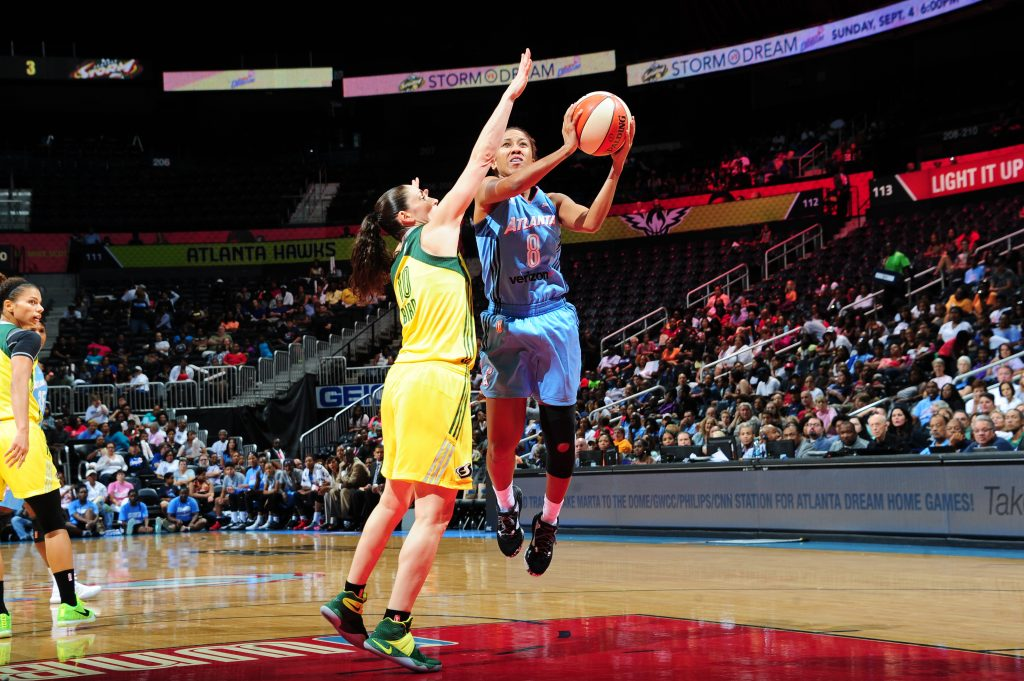 ATLANTA, GA - SEPTEMBER 4: Carla Cortijo #8 of the Atlanta Dream shoots the ball against the Seattle Storm on September 4, 2016 at Philips Arena in Atlanta, Georgia. NOTE TO USER: User expressly acknowledges and agrees that, by downloading and/or using this Photograph, user is consenting to the terms and conditions of the Getty Images License Agreement. Mandatory Copyright Notice: Copyright 2016 NBAE (Photo by Scott Cunningham/NBAE via Getty Images)