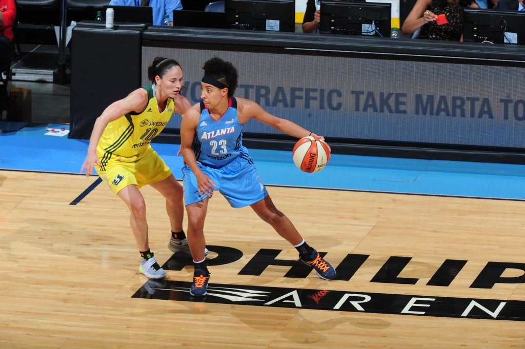 ATLANTA, GA - JULY 5: Layshia Clarendon #23 of the Atlanta Dream handles the ball against Sue Bird #10 of the Seattle Storm on July 5, 2016 at Philips Arena in Atlanta, Georgia. NOTE TO USER: User expressly acknowledges and agrees that, by downloading and/or using this Photograph, user is consenting to the terms and conditions of the Getty Images License Agreement. Mandatory Copyright Notice: Copyright 2016 NBAE (Photo by Scott Cunningham/NBAE via Getty Images)