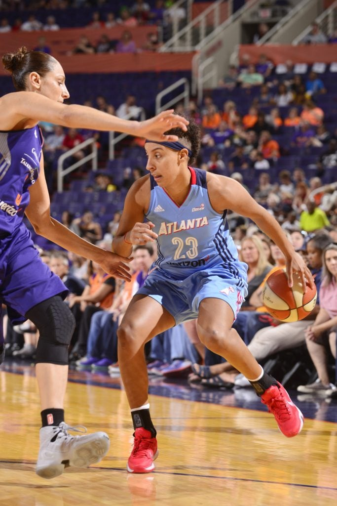 PHOENIX, AZ - SEPTEMBER 11: Layshia Clarendon #23 of the Atlanta Dream handles the ball against the Phoenix Mercury on September 11, 2016 at Talking Stick Resort Arena in Phoenix, Arizona. NOTE TO USER: User expressly acknowledges and agrees that, by downloading and or using this Photograph, user is consenting to the terms and conditions of the Getty Images License Agreement. Mandatory Copyright Notice: Copyright 2016 NBAE (Photo by Barry Gossage/NBAE via Getty Images)