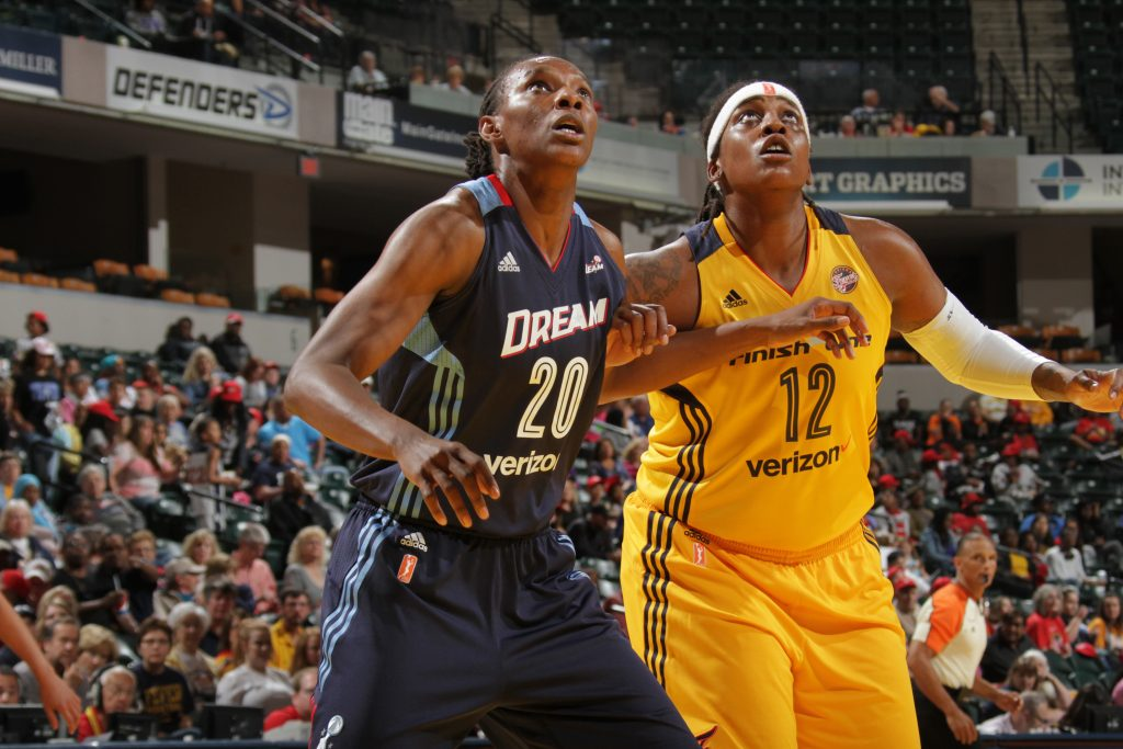 INDIANAPOLIS, IN - MAY 20: Sancho Lyttle #20 of the Atlanta Dream fights for position against Lynetta Kizer #12 of the Indiana Fever on May 20, 2016 at Bankers Life Fieldhouse in Indianapolis, Indiana. NOTE TO USER: User expressly acknowledges and agrees that, by downloading and or using this Photograph, user is consenting to the terms and conditions of the Getty Images License Agreement. Mandatory Copyright Notice: Copyright 2016 NBAE (Photo by Ron Hoskins/NBAE via Getty Images)