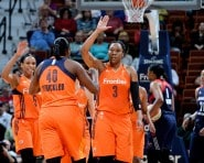 UNCASVILLE, CT - MAY 21:  Kelsey Bone #3 and Shekinna Stricklen #40 of the Connecticut Sun high five during the game against the Washington Mystics on May 21, 2016 at the Mohegan Sun Arena in Uncasville, Connecticut.