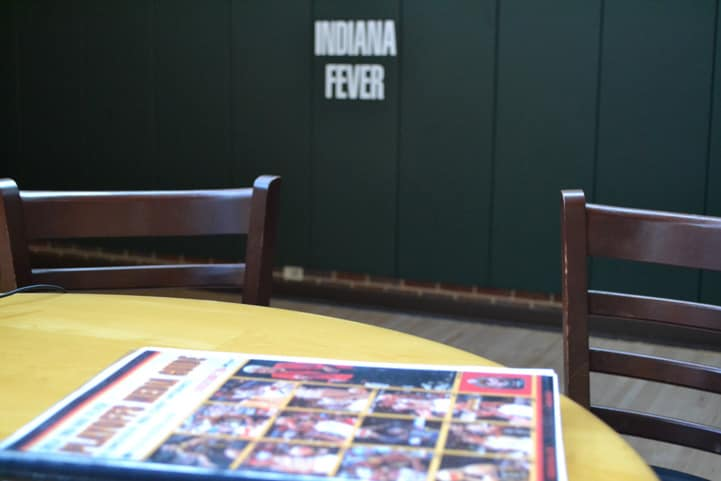 Last year's playoff media guide sits on a table.