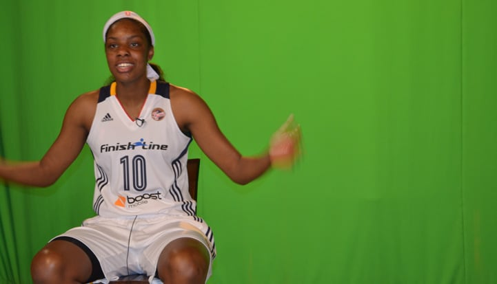 Chelsea Gardner (#10) during a photoshoot in front of a green screen.