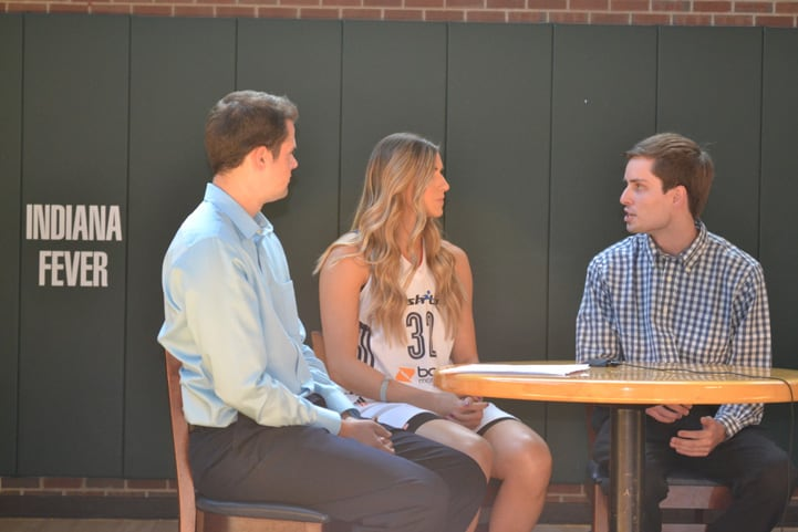 Jeanette Pohlen (#32) talks with two men from feverbasketball.com at a table during Indiana Fever Media Day.