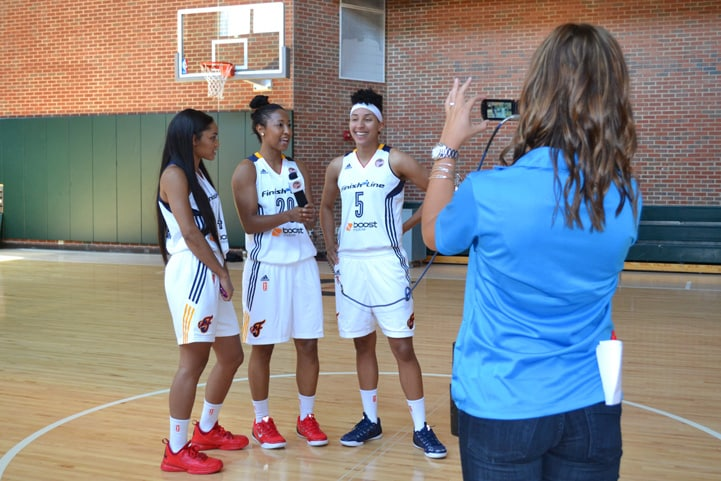 Sydney Carter (left), Briann January (#20) and Layshia Clarendon (#5) pose for a photo during Indiana Fever Media Day.