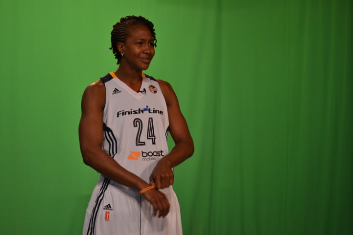 Tamika Catchings prepares for the 2015 season with her team on media day.