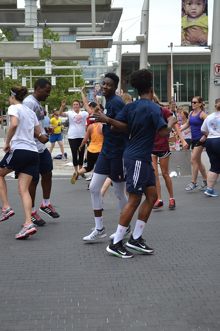Howard and Johnson partner up during zumba at Workout Wednesday