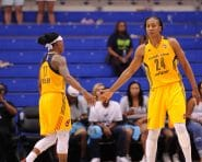 ARLINGTON, TX - JUNE 25:  Tamika Catchings #24 of the Indiana Fever high fives Erica Wheeler #17 of the Indiana Fever during the game against the Dallas Wings on June 25, 2016 at College Park Center in Arlington, Texas. NOTE TO USER: User expressly acknowledges and agrees that, by downloading and or using this photograph, user is consenting to the terms and conditions of the Getty Images License Agreement. Mandatory Copyright Notice: Copyright 2016 NBAE (Photos by Sergio Hentschel/NBAE via Getty Images)