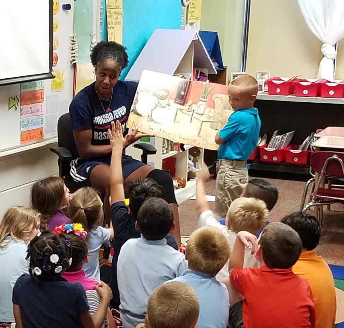 Shenise Johnson reads to students