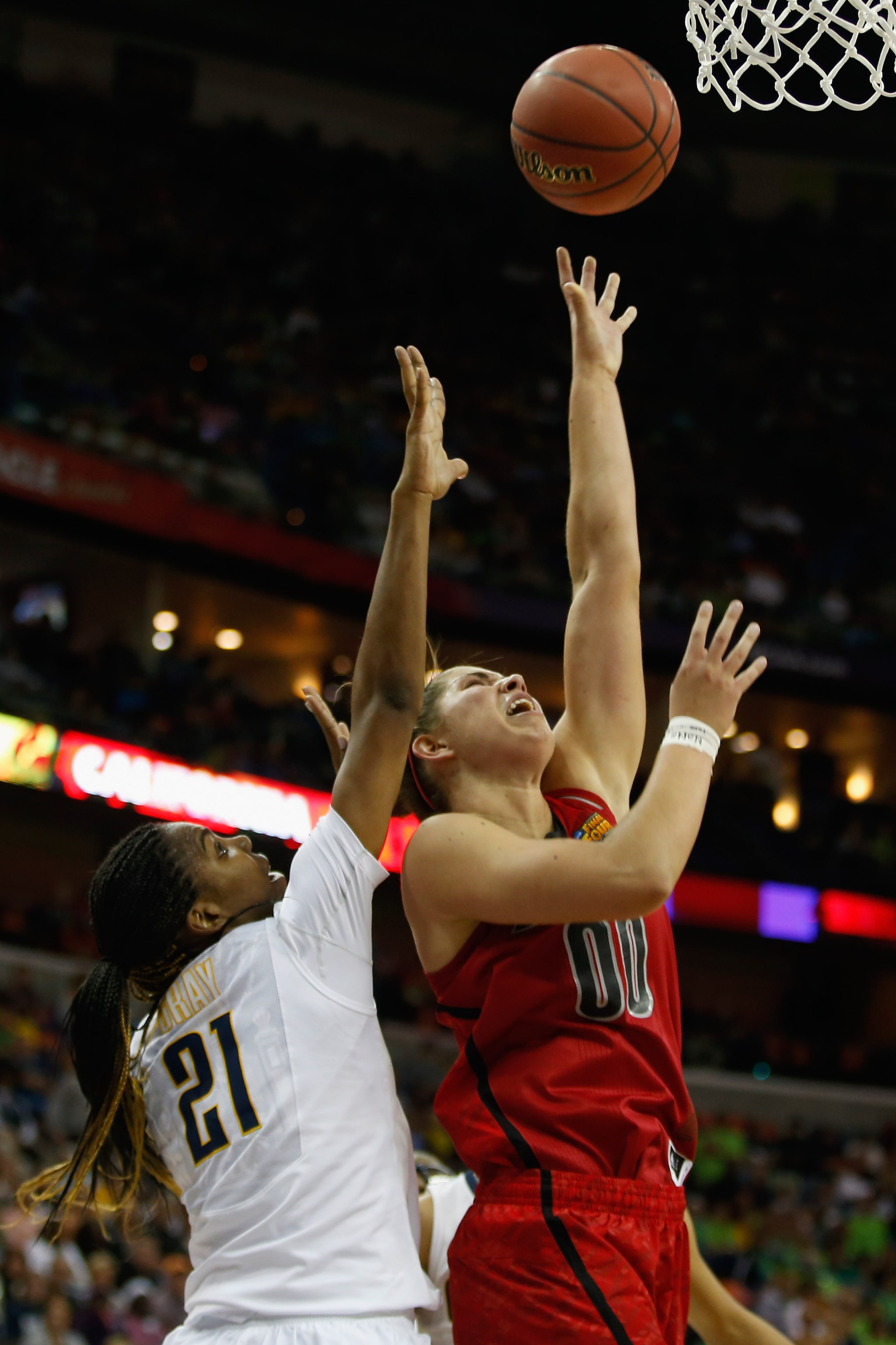 NEW ORLEANS, LA - APRIL 07:  Sara Hammond #00 of the Louisville Cardinals shoots the ball over Reshanda Gray #21 of the California Golden Bears during the National Semifinal game of the 2013 NCAA Division I Women's Basketball Championship at the New Orleans Arena on April 7, 2013 in New Orleans, Louisiana.  (Photo by Chris Graythen/Getty Images)