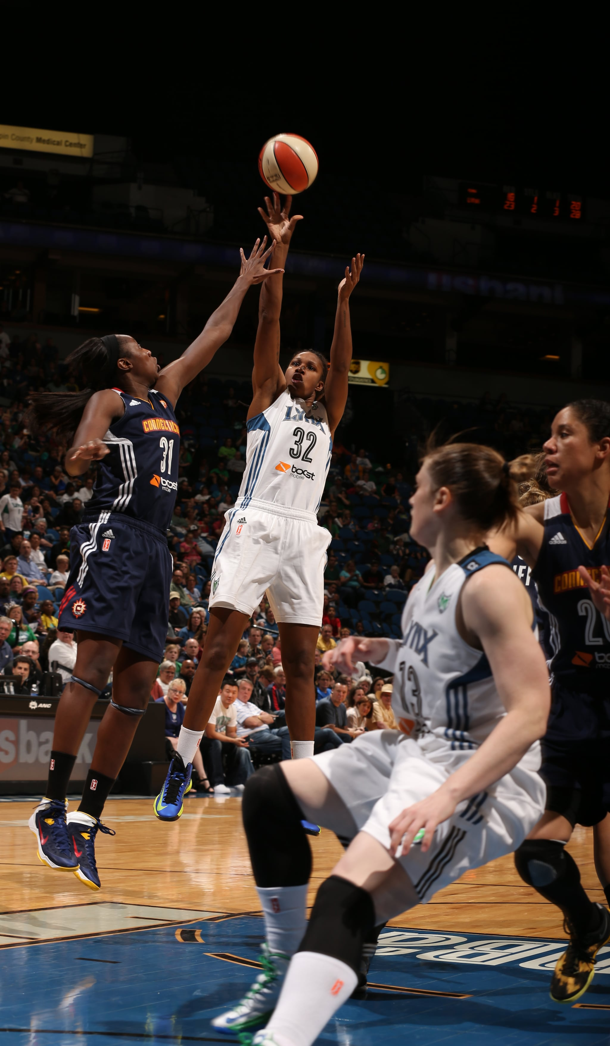 2013's Home-Opener: Lynx forward Rebekkah Brunson knocks down a jumper for two of her 12 points on the night. The Lynx defeated the Connecticut Sun 90-74.