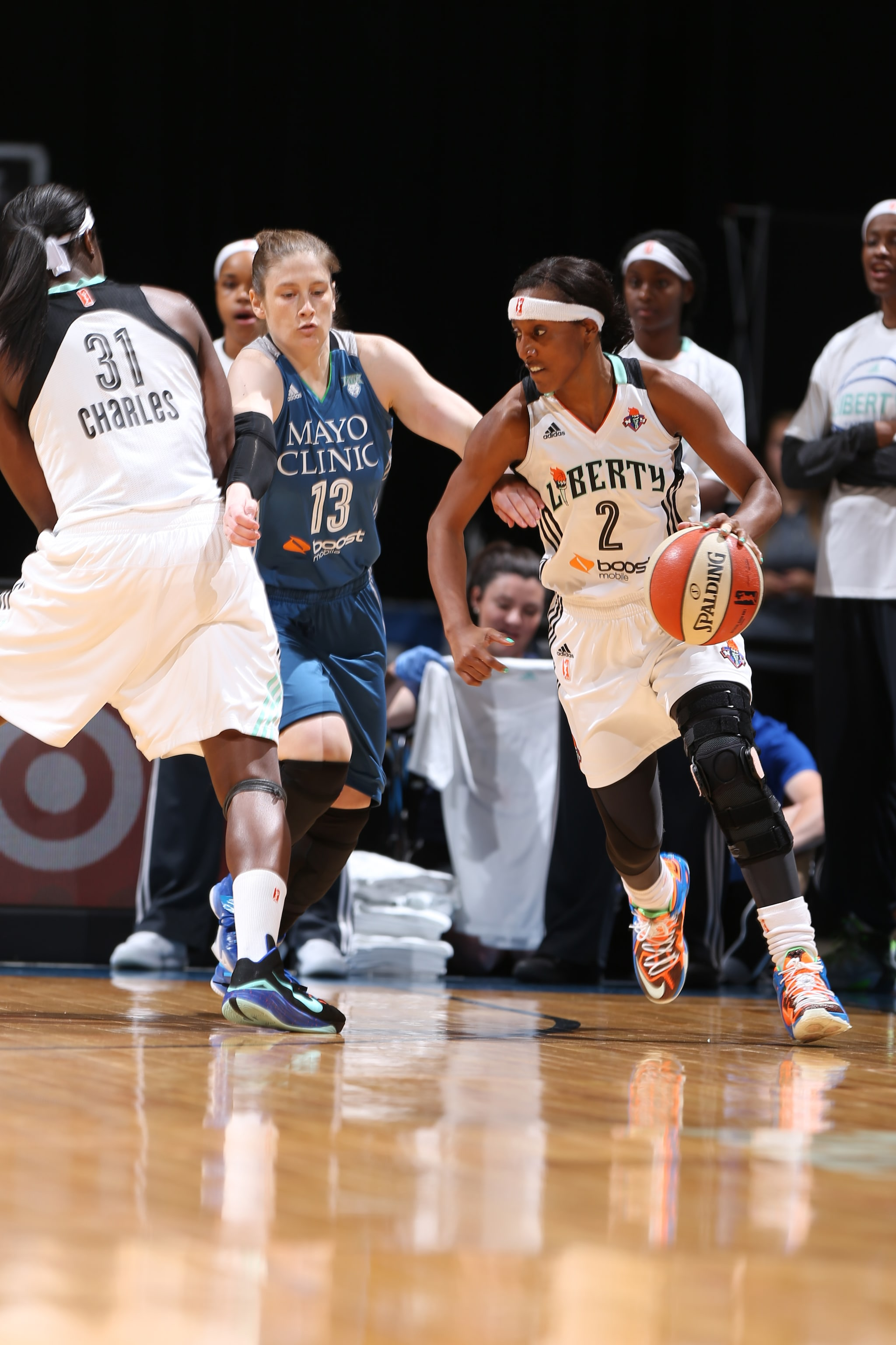 MINNEAPOLIS, MN - JUNE 1:  Candice Wiggins #2 of the New York Liberty handles the ball against Lindsay Whalen #13 of the Minnesota Lynx on June 1, 2015 at Target Center in Minneapolis, Minnesota. NOTE TO USER: User expressly acknowledges and agrees that, by downloading and or using this Photograph, user is consenting to the terms and conditions of the Getty Images License Agreement. Mandatory Copyright Notice: Copyright 2015 NBAE (Photo by David Sherman/NBAE via Getty Images)