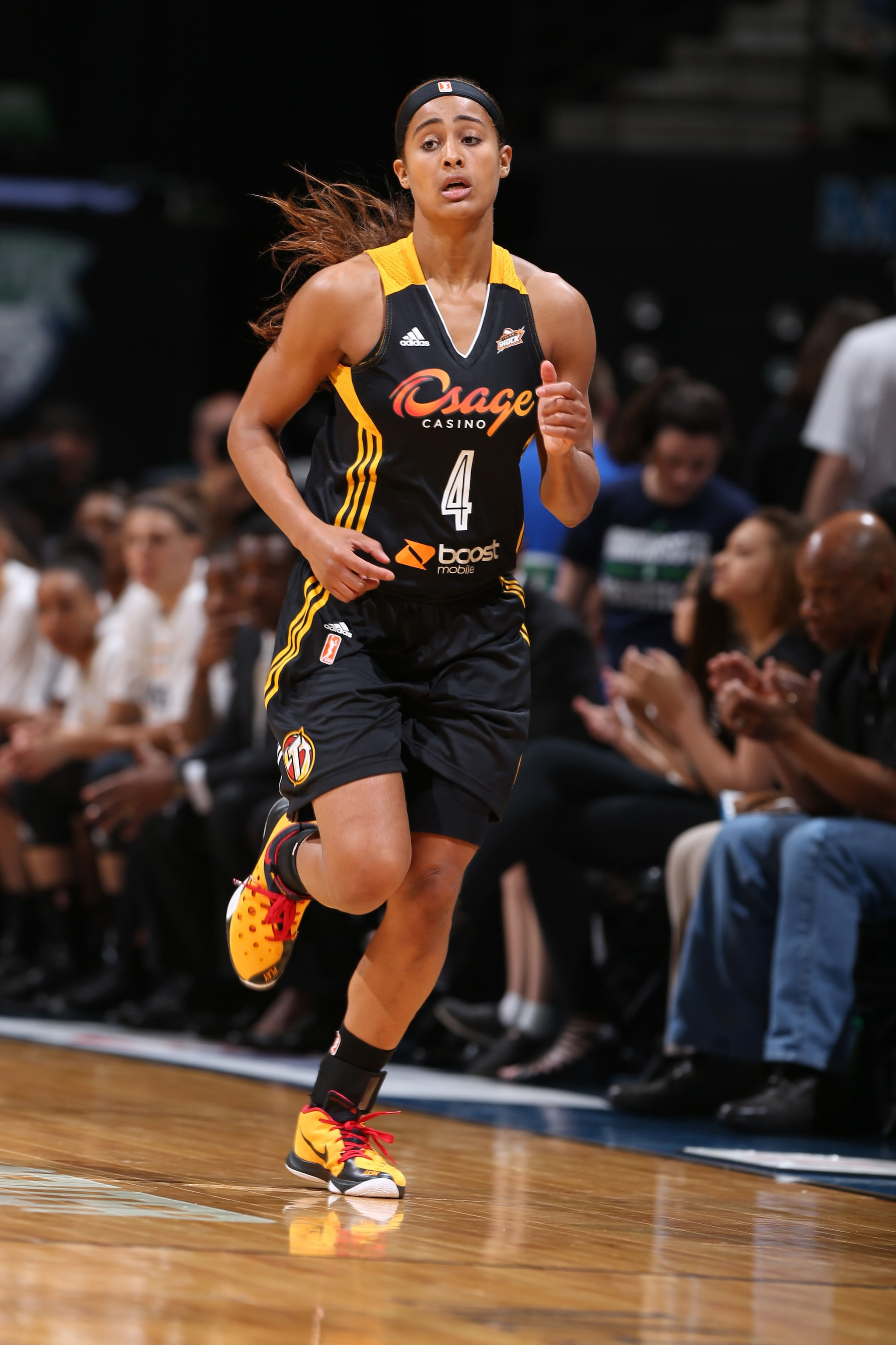 MINNEAPOLIS, MN - JUNE 5:  Skylar Diggins #4 of the Tulsa Shock runs down the court against the Minnesota Lynx during the season opener of their WNBA game on June 5, 2015 at Target Center in Minneapolis, Minnesota. NOTE TO USER: User expressly acknowledges and agrees that, by downloading and or using this Photograph, user is consenting to the terms and conditions of the Getty Images License Agreement. Mandatory Copyright Notice: Copyright 2015 NBAE (Photo by David Sherman/NBAE via Getty Images)