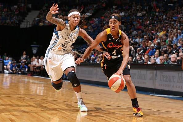 MINNEAPOLIS, MN - JUNE 5:  Skylar Diggins #4 of the Tulsa Shock drives to the basket against Seimone Augustus #5 of the Minnesota Lynx during the season opener of their WNBA game on June 5, 2015 at Target Center in Minneapolis, Minnesota. NOTE TO USER: User expressly acknowledges and agrees that, by downloading and or using this Photograph, user is consenting to the terms and conditions of the Getty Images License Agreement. Mandatory Copyright Notice: Copyright 2015 NBAE (Photo by David Sherman/NBAE via Getty Images)