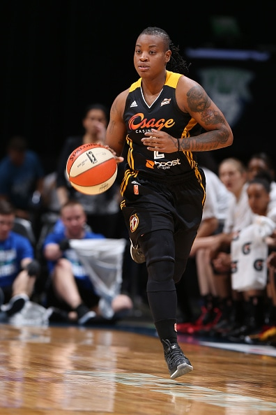 MINNEAPOLIS, MN - JUNE 5:  Riquna Williams #2 of the Tulsa Shock brings the ball up court against the Minnesota Lynx during the season opener of their WNBA game on June 5, 2015 at Target Center in Minneapolis, Minnesota. NOTE TO USER: User expressly acknowledges and agrees that, by downloading and or using this Photograph, user is consenting to the terms and conditions of the Getty Images License Agreement. Mandatory Copyright Notice: Copyright 2015 NBAE (Photo by David Sherman/NBAE via Getty Images)