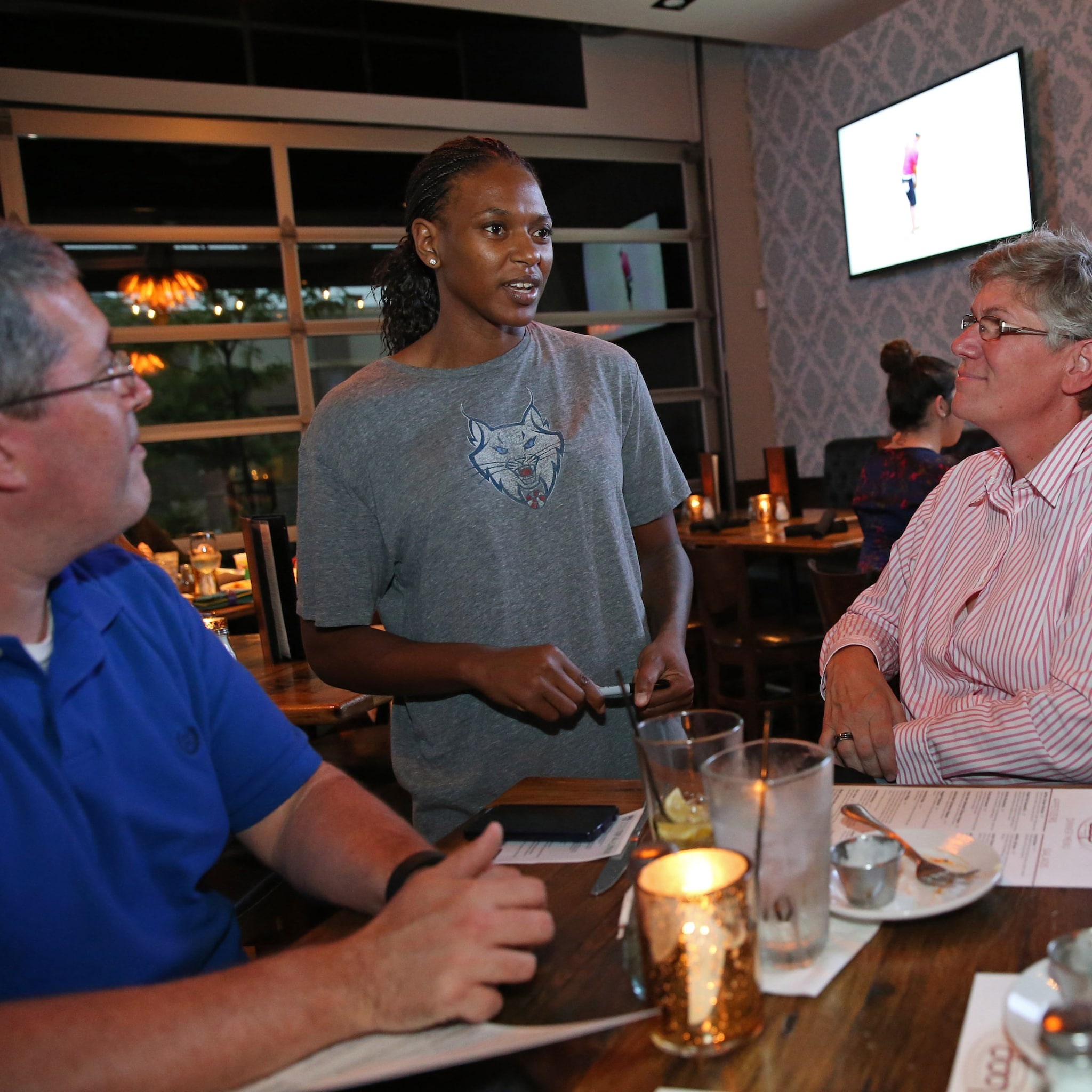MINNEAPOLIS, MN - JUNE 3:  Asjha Jones #15 of the Minnesota Lynx takes food orders during the Tip-A-Lynx fundraiser to benefit the Minnesota Lynx Fastbreak Foundation on June 3, 2015 at the Loop West End Bar & Restaurant in Minneapolis, Minnesota.  NOTE TO USER: User expressly acknowledges and agrees that, by downloading and or using this Photograph, user is consenting to the terms and conditions of the Getty Images License Agreement. Mandatory Copyright Notice: Copyright 2015 NBAE (Photo by David Sherman/NBAE via Getty Images)