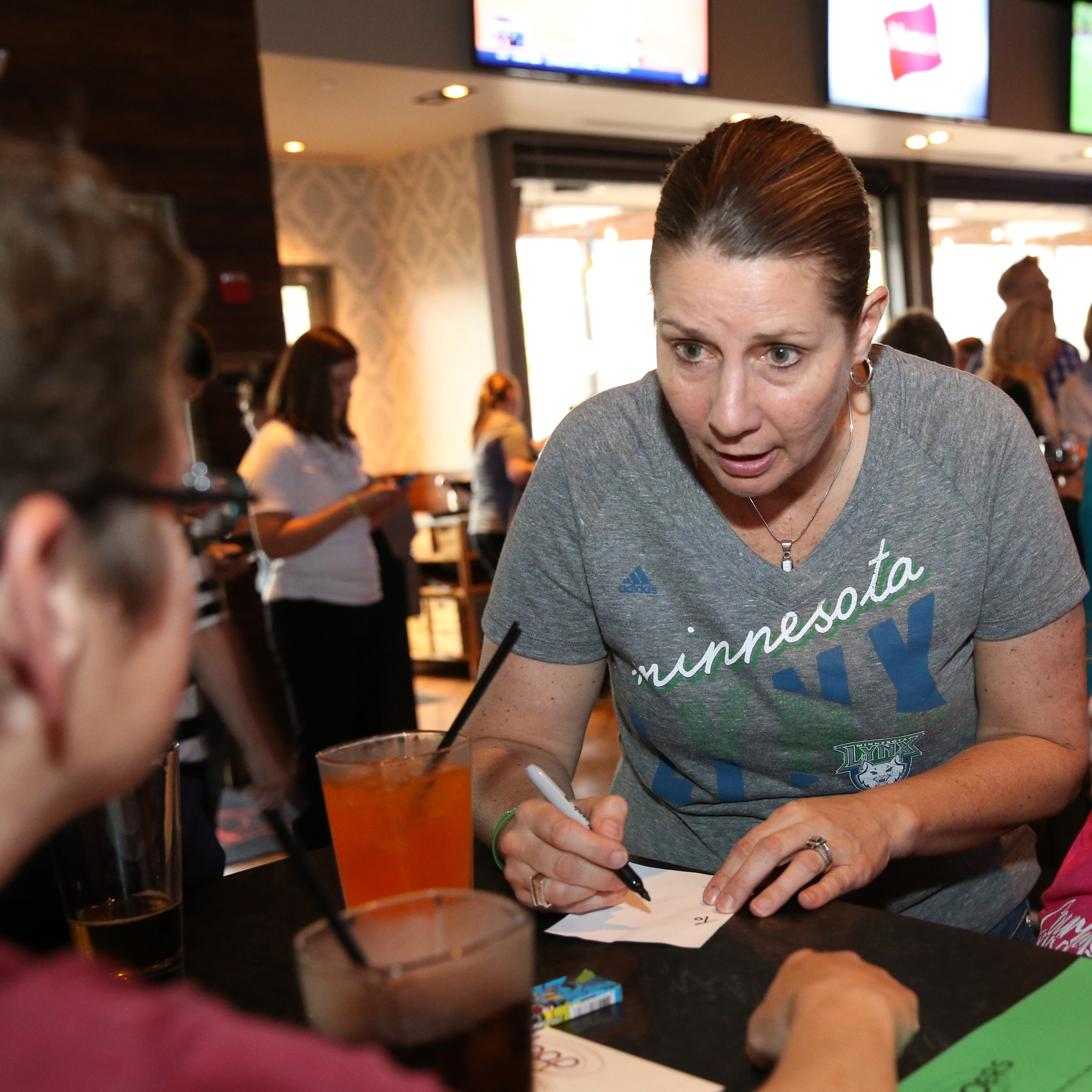 MINNEAPOLIS, MN - JUNE 3:  Cheryl Reeves of the Minnesota Lynx takes food orders during the Tip-A-Lynx fundraiser to benefit the Minnesota Lynx Fastbreak Foundation on June 3, 2015 at the Loop West End Bar & Restaurant in Minneapolis, Minnesota.  NOTE TO USER: User expressly acknowledges and agrees that, by downloading and or using this Photograph, user is consenting to the terms and conditions of the Getty Images License Agreement. Mandatory Copyright Notice: Copyright 2015 NBAE (Photo by David Sherman/NBAE via Getty Images)