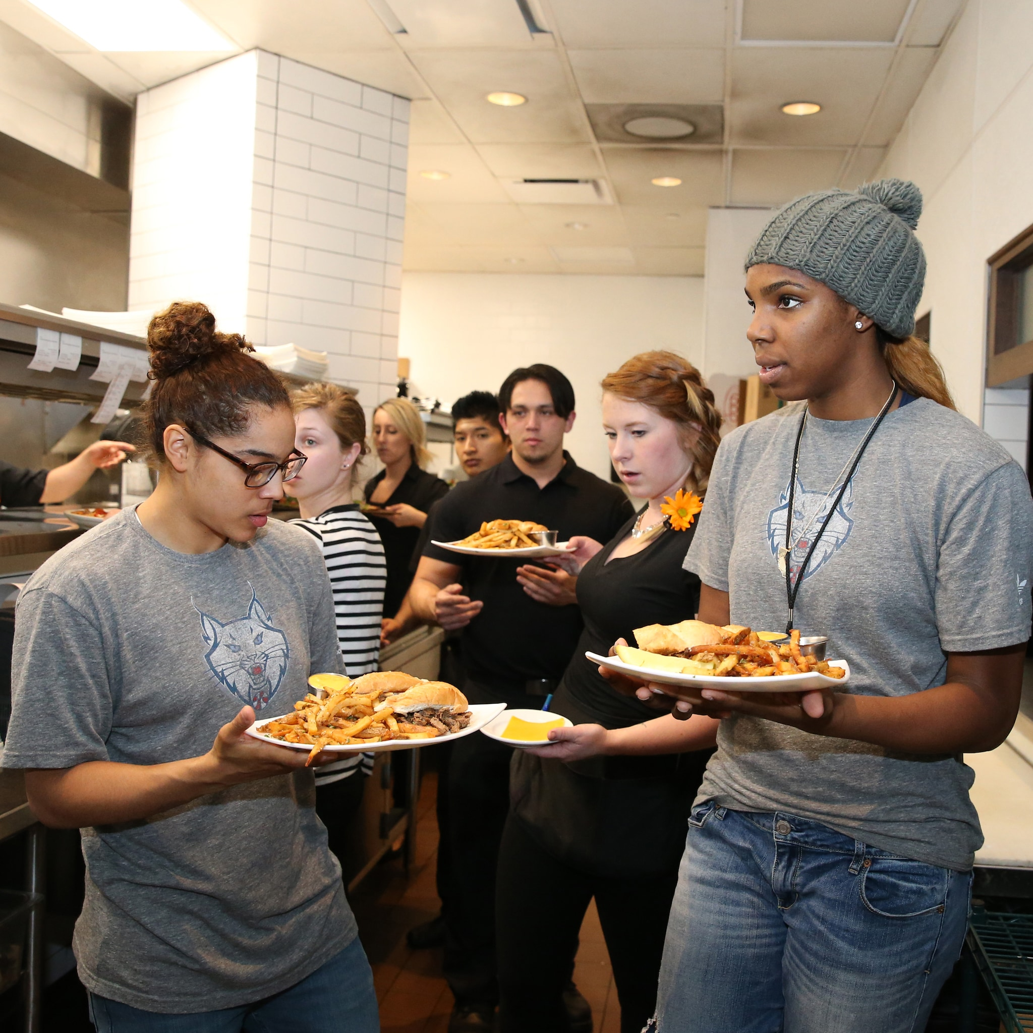 MINNEAPOLIS, MN - JUNE 3:  Jennifer O'Neill #0 and Reshanda Gray #21 of the Minnesota Lynx serve food during the Tip-A-Lynx fundraiser to benefit the Minnesota Lynx Fastbreak Foundation on June 3, 2015 at the Loop West End Bar & Restaurant in Minneapolis, Minnesota.  NOTE TO USER: User expressly acknowledges and agrees that, by downloading and or using this Photograph, user is consenting to the terms and conditions of the Getty Images License Agreement. Mandatory Copyright Notice: Copyright 2015 NBAE (Photo by David Sherman/NBAE via Getty Images)