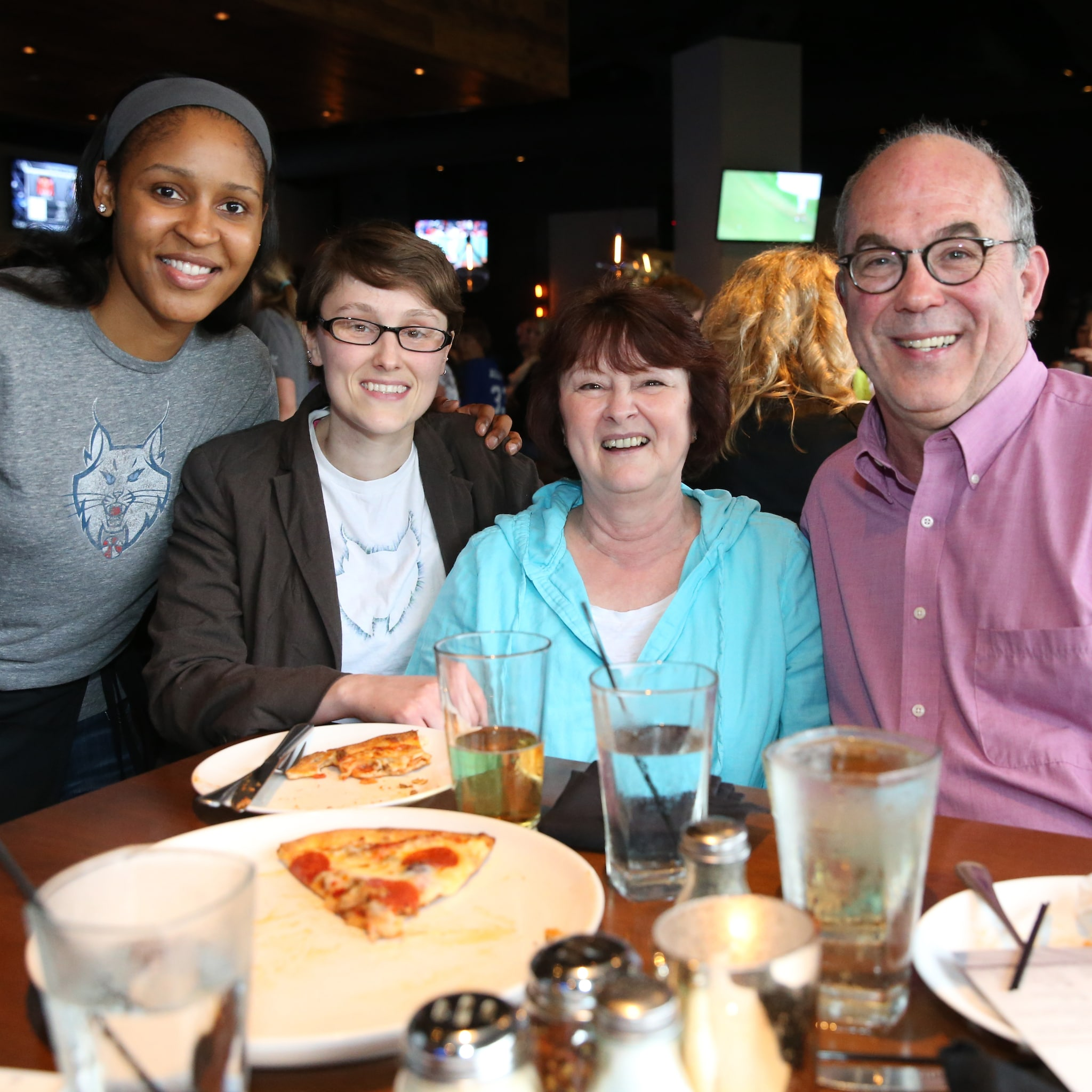 MINNEAPOLIS, MN - JUNE 3:  Maya Moore #23 of the Minnesota Lynx poses with fans during the Tip-A-Lynx fundraiser to benefit the Minnesota Lynx Fastbreak Foundation on June 3, 2015 at the Loop West End Bar & Restaurant in Minneapolis, Minnesota.  NOTE TO USER: User expressly acknowledges and agrees that, by downloading and or using this Photograph, user is consenting to the terms and conditions of the Getty Images License Agreement. Mandatory Copyright Notice: Copyright 2015 NBAE (Photo by David Sherman/NBAE via Getty Images)