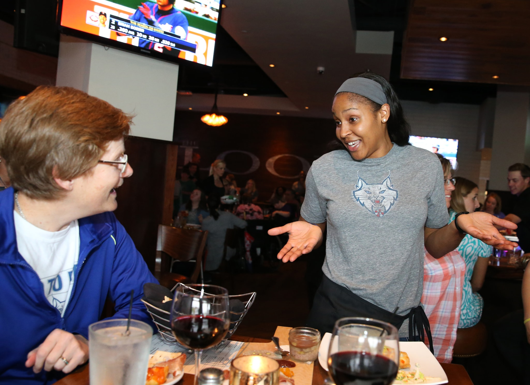 MINNEAPOLIS, MN - JUNE 3:  Maya Moore #23 of the Minnesota Lynx talks with fans during the Tip-A-Lynx fundraiser to benefit the Minnesota Lynx Fastbreak Foundation on June 3, 2015 at the Loop West End Bar & Restaurant in Minneapolis, Minnesota.  NOTE TO USER: User expressly acknowledges and agrees that, by downloading and or using this Photograph, user is consenting to the terms and conditions of the Getty Images License Agreement. Mandatory Copyright Notice: Copyright 2015 NBAE (Photo by David Sherman/NBAE via Getty Images)