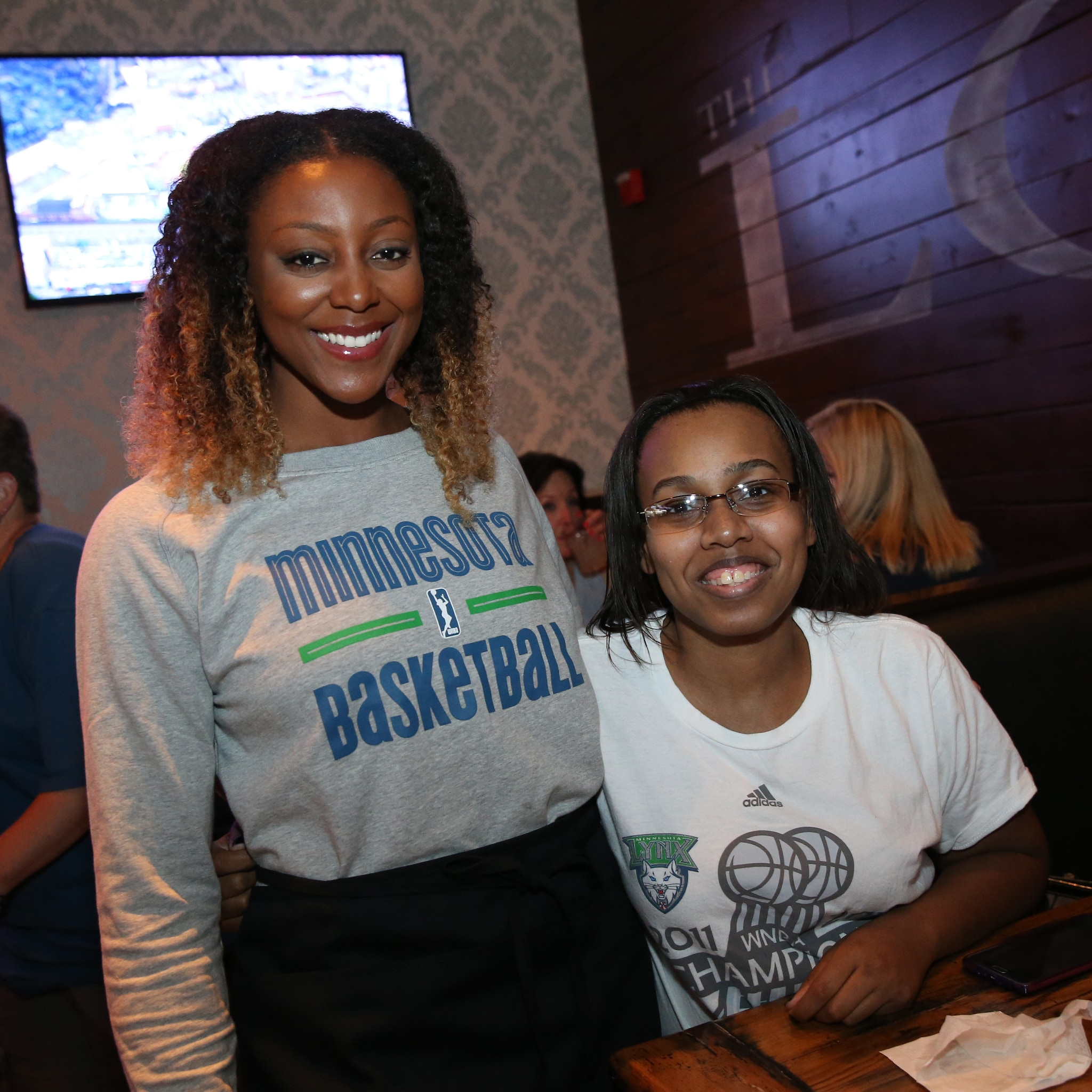 MINNEAPOLIS, MN - JUNE 3:  Monica Wright #22 of the Minnesota Lynx poses with a fan during the Tip-A-Lynx fundraiser to benefit the Minnesota Lynx Fastbreak Foundation on June 3, 2015 at the Loop West End Bar & Restaurant in Minneapolis, Minnesota.  NOTE TO USER: User expressly acknowledges and agrees that, by downloading and or using this Photograph, user is consenting to the terms and conditions of the Getty Images License Agreement. Mandatory Copyright Notice: Copyright 2015 NBAE (Photo by David Sherman/NBAE via Getty Images)