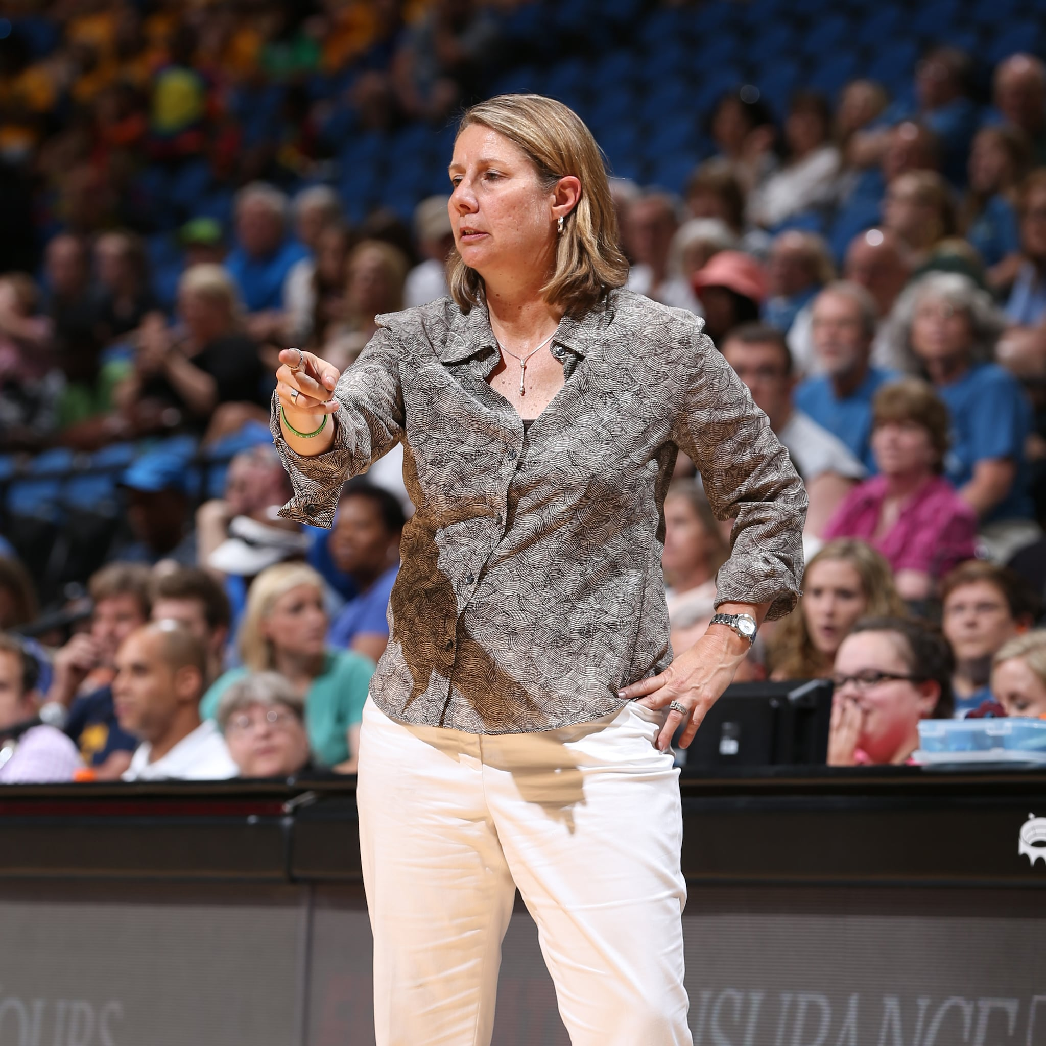 MINNEAPOLIS, MN - JULY 22: Cheryl Reeve of the Minnesota Lynx stands on the court during a game against the Connecticut Sun on July 22, 2015 at Target Center in Minneapolis, Minnesota. NOTE TO USER: User expressly acknowledges and agrees that, by downloading and or using this Photograph, user is consenting to the terms and conditions of the Getty Images License Agreement. Mandatory Copyright Notice: Copyright 2015 NBAE (Photo by David Sherman/NBAE via Getty Images)