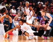 PHOENIX, AZ - AUGUST 23: Monique Currie #25 of the Phoenix Mercury dives for a loose ball against Maya Moore #23 of the Minnesota Lynx on August 23, 2015 in Phoenix, Arizona. NOTE TO USER: User expressly acknowledges and agrees that, by downloading and or using this Photograph, user is consenting to the terms and conditions of the Getty Images License Agreement. Mandatory Copyright Notice: Copyright 2015 NBAE (Photo by Barry Gossage/NBAE via Getty Images)